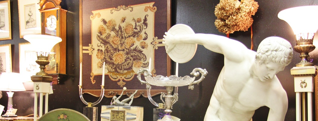 Antiques, collectibles, or vintage items on display by Dealer 35 at Warson Woods Antiques Gallery in St. Louis.