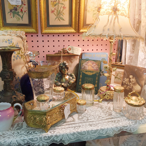 Antiques, collectibles, or vintage items on display by Dealer 10 at Warson Woods Antiques Gallery.