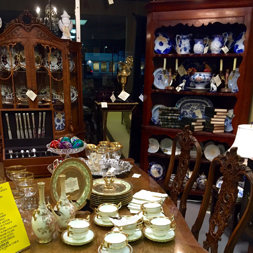 Antiques, collectibles, or vintage items on display by Dealer 110 at Warson Woods Antiques Gallery.