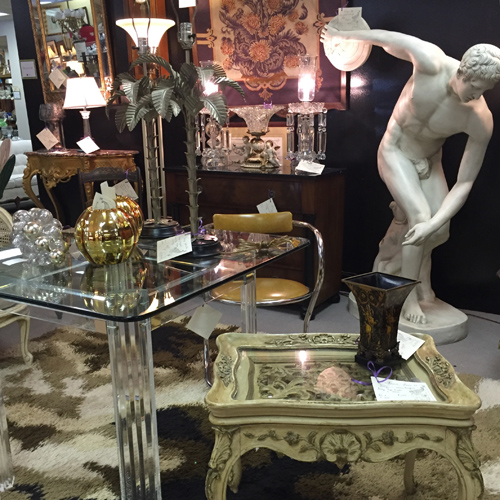 Antiques, collectibles, or vintage items on display by Dealer 2 at Warson Woods Antiques Gallery.