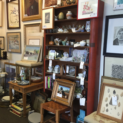 Oil paintings, Flow Blue China, and other antique furnishings on offer by Dealer 4 at the Warson Woods Antiques Gallery.