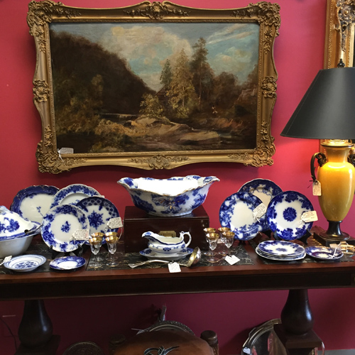Oil paintings, Flow Blue China, and other antique furnishings on offer by Dealer 5 at the Warson Woods Antiques Gallery.