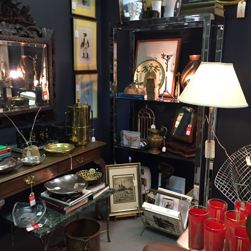 Antiques, collectibles, or vintage items on display by Dealer 64 at Warson Woods Antiques Gallery.