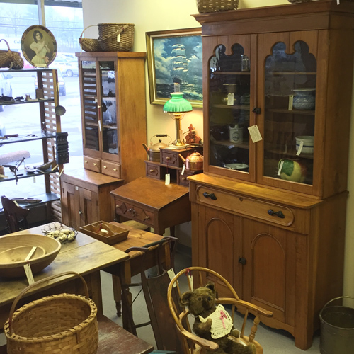Early American and Country Primitive furnishings on offer by Dealer 7 at the Warson Woods Antiques Gallery.